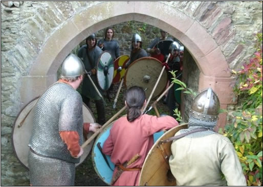 Viking warriors fighting amonst the ruins